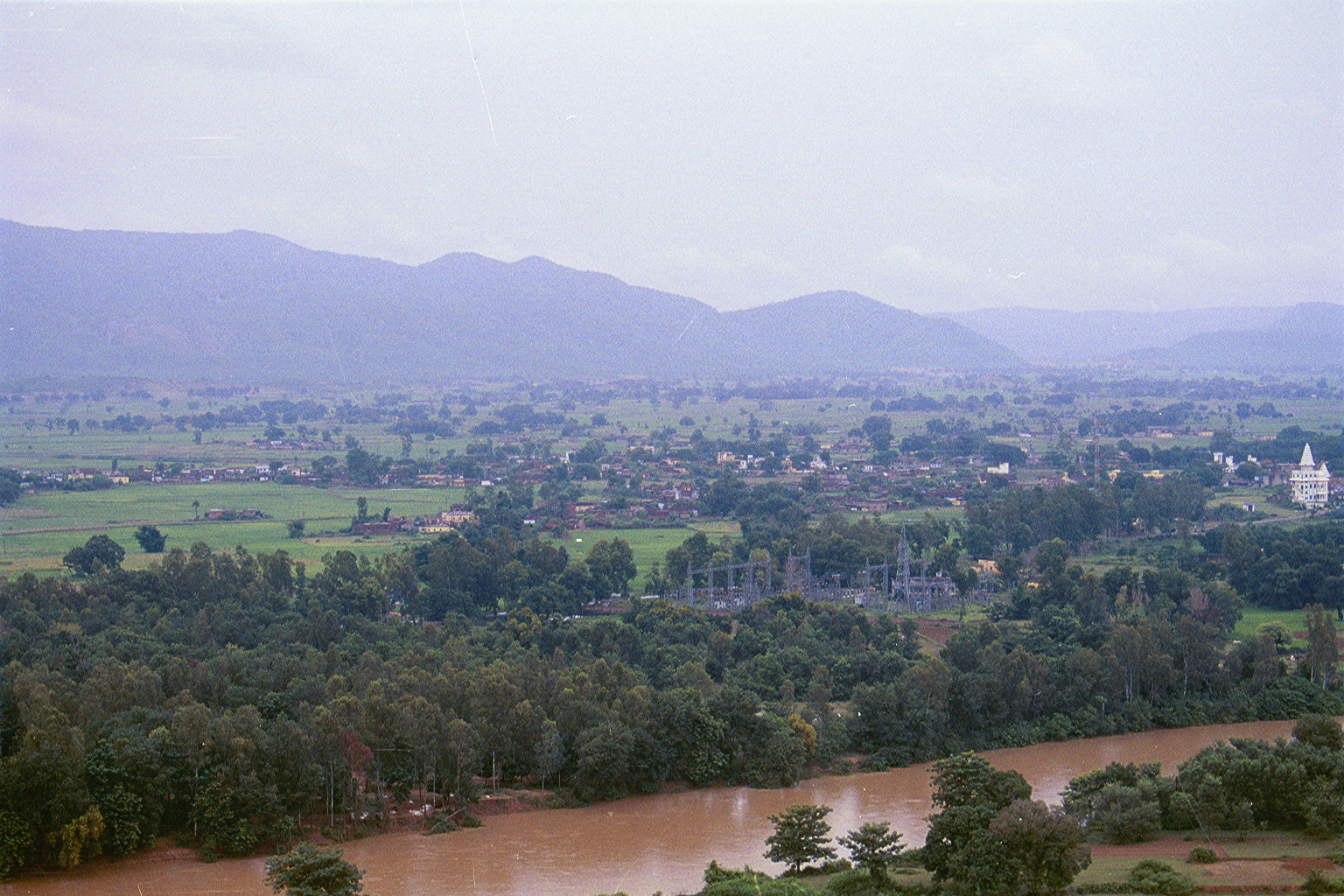 View of 'Mallehpur', in the distant, from the 'Shiva' temple up in the hills