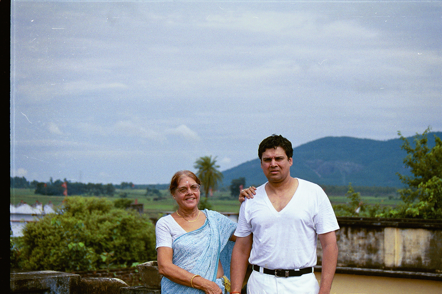 Mom and myself standing on the roof of the house, early in the morning, before breakfast
