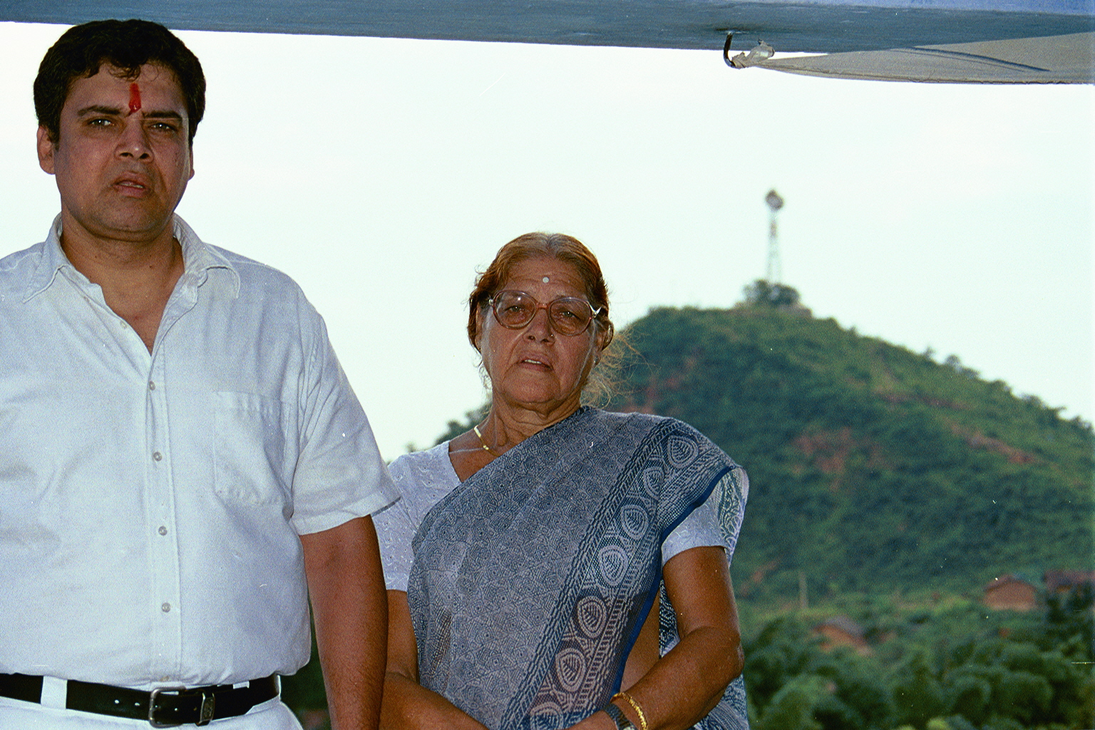 Me and Mom at the temple offering prayers for the soul of my late father