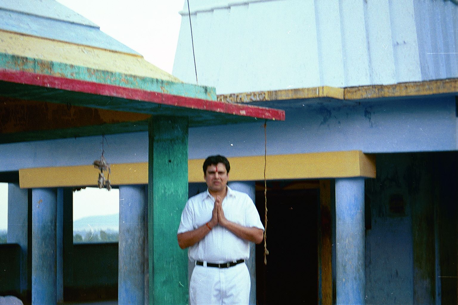 Myself visiting Mallehpur (2002); for the 1st time since I left India, in 1979. Praying at the SHIVA temple. ( PLEASE DO NOT LET ME DOWN ! I HAVE GREAT FAITH & HOPE IN YOU ! PLEASE )