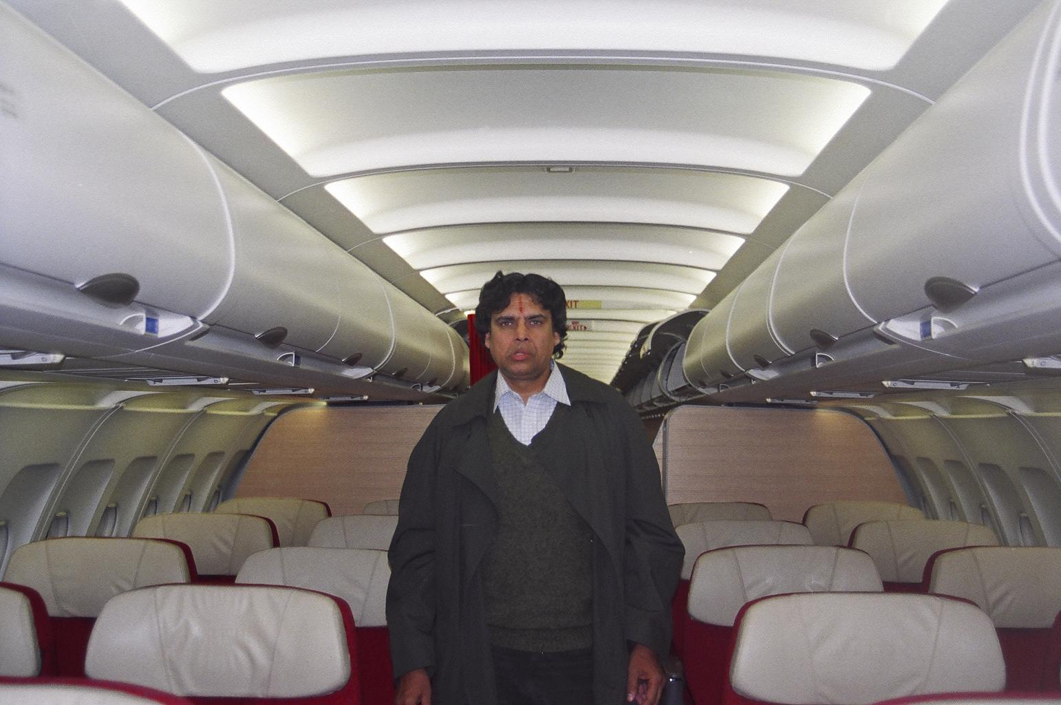 Myself in the Kingfisher Airlines Airbus-330; Tired & weary after the flight back to Calcutta from New Delhi