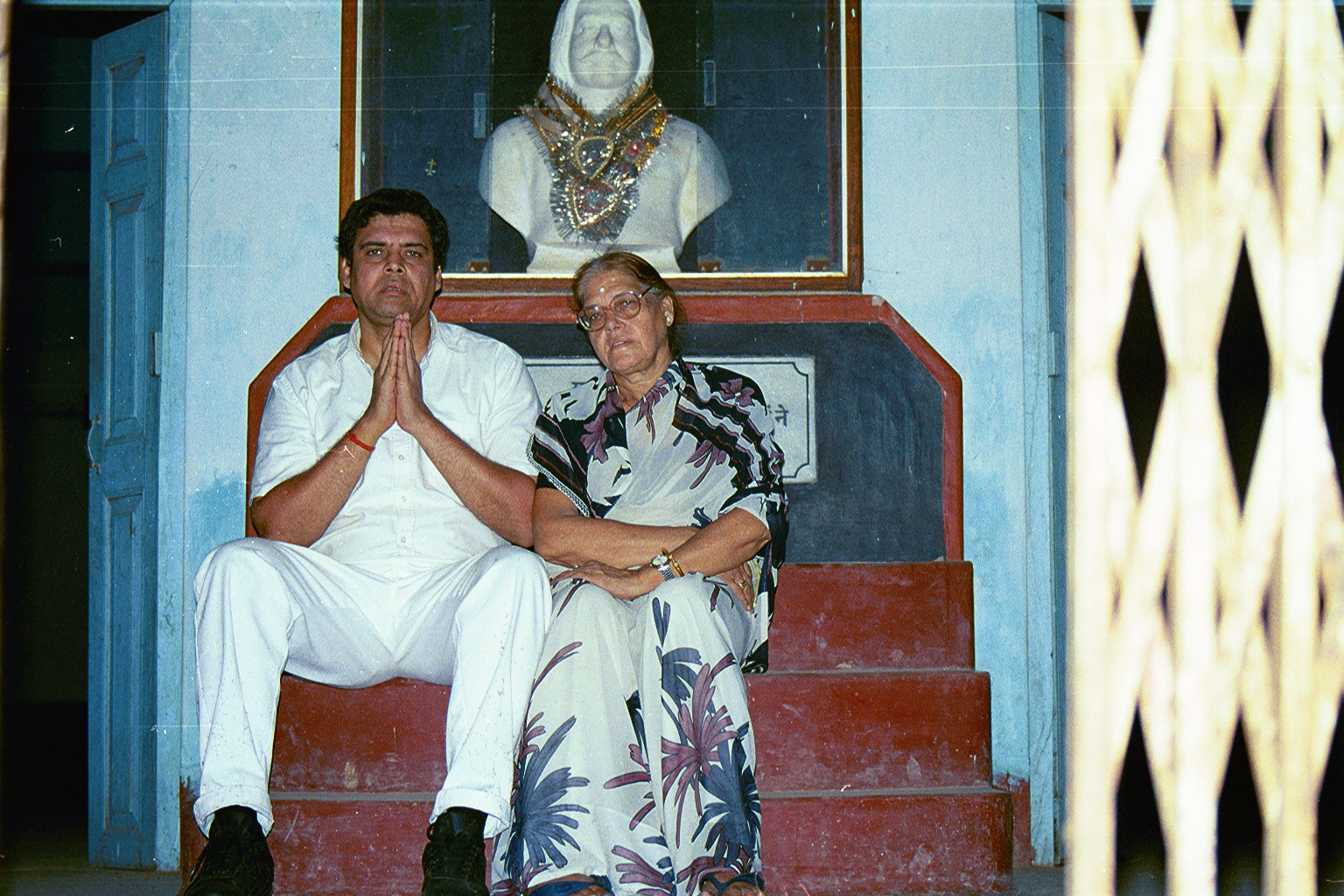 Myself with mom under my Great-grandfather Mr J. P. Chaturvedi's marble bust commerated for him at Mallehpur railway station.